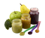 Three baby food jars with spoons Royalty Free Stock Images