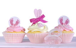 Three baby girl cupcakes against a white background Royalty Free Stock Image