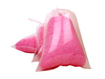 Three Bags Candy Floss. Three translucent plastic Bags of fluffy & mouth watering Candy Floss stock photo