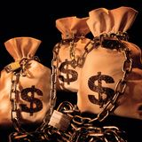 Three bags with dollars Stock Images