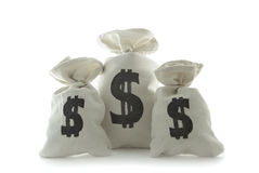 Three bags with money. On the white background stock photos