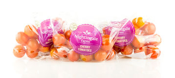 Three bags of Nightingale Farms cherry tomatoes from Tesco. WREXHAM, UK - MAY 24, 2017: Three bags of Nightingale Farms cherry tomatoes exclusively for Tesco on Stock Photography