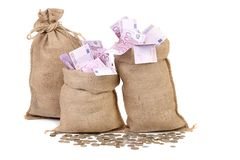 Three Bags With Many Euro Banknotes. Royalty Free Stock Photo