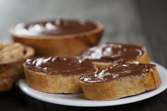 Three baguette slices with chocolate hazelnut spread Royalty Free Stock Photography