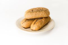 Three baguettes on an off-white plate Royalty Free Stock Photo