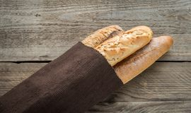 Three baguettes on the wooden background Stock Photo