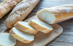 Three baguettes on the wooden background Royalty Free Stock Images