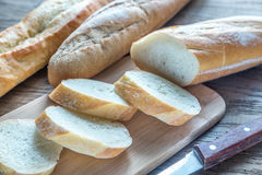 Three baguettes on the wooden background Stock Image