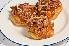 Three baked pecan croissant roles Royalty Free Stock Image