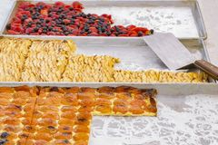 Three baking sheets with a verity of fruit pastries royalty free stock photo