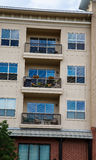 Three Balconies on Condo Building. Balconies on a paster condo building Royalty Free Stock Photography