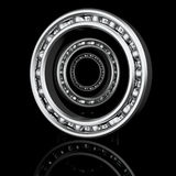 Three ball-bearings with different angles. On a black background with reflection Stock Photography