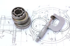 Three ball bearings over and over with micrometer royalty free stock photography