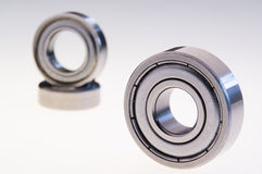 Three ball bearings on white Stock Photos