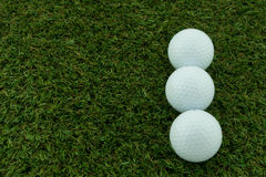Three ball. Three golf ball on the artificial grass Royalty Free Stock Photography