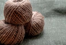 Three ball of twine on the background of green burlap.  royalty free stock image