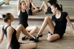 Three ballet dancers on the floor Stock Photography