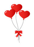 Three Balloons. Three heart-shaped balloons with a bow on white background Stock Photo
