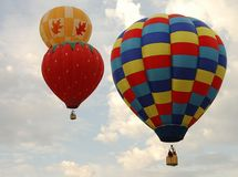 Three balloons. Three hot air balloons on a partly cloudy sky Stock Photo