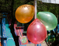 Three balloons. Three colorful balloons tied outdoor Royalty Free Stock Photos