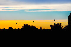 Three balloons in the sky of Ferrara Royalty Free Stock Images