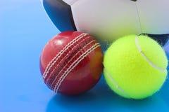 Three balls. Soccer,tennis and crickert balls Royalty Free Stock Image