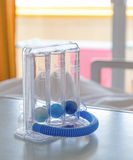 Three balls Incentive Spirometer for deep breathing Stock Images