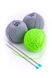 Three Balls Of Wool And Two Knitting Needles Royalty Free Stock Photography