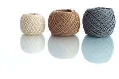Three balls of rope. Three  balls of twine on a white background Stock Image