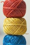 Three balls of string stock photos