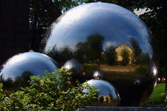 Three balls. There are balls of different sizes from which water flows Stock Images