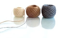 Three  balls of twine. On a white background Royalty Free Stock Image
