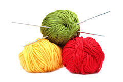 Three balls of wool with knitting needles Stock Image