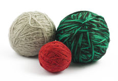 Three balls of wool on white background. (red, green and grey Stock Images