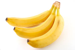 Three bananas. Against a white background Royalty Free Stock Images