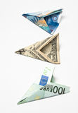 Three banknote planes. Dollar, euro and swiss frank. on a white background Stock Photo