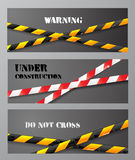 Three banners with danger tapes Stock Photography