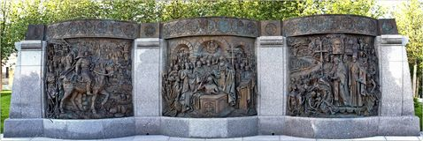 Three Bas-reliefs dedicated to the Baptism of Russia near the monument to Prince Vladimir on Borovitskaya square. Moscow, Russia royalty free stock images
