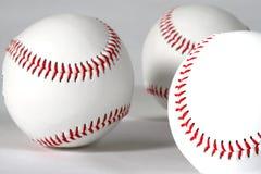 Three baseballs. Close-up on white background showing seams Stock Image