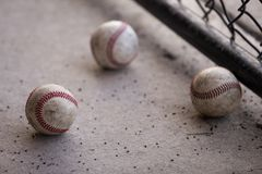 Three Baseballs in the Dugout royalty free stock photography
