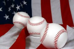 Three baseballs and flag. Three baseballs close-up on American flag Stock Photos