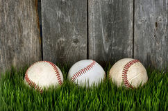 Three Baseballs on grass. Royalty Free Stock Image