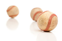 Three Baseballs Isolated on Reflective White Royalty Free Stock Photos