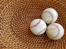 Three baseballs in wicker basket Royalty Free Stock Photography