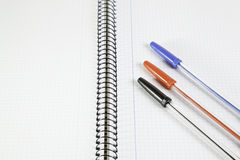Three basic color pens on a notebook Royalty Free Stock Image