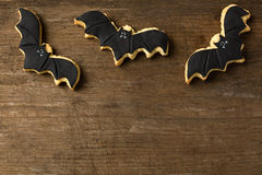 Three bat flying on wood background. Halloween Stock Photography