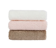 Three bath towels on white background. Isolated over white Royalty Free Stock Photos