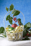 Three baubles in Christmas basket Royalty Free Stock Photo