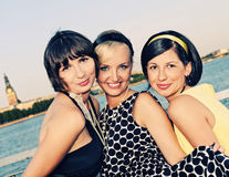 Three bautiful woman outdoors stock images