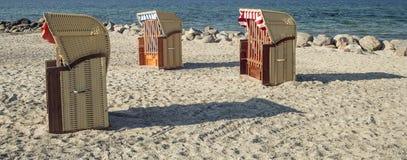 Three beach chairs Stock Photography